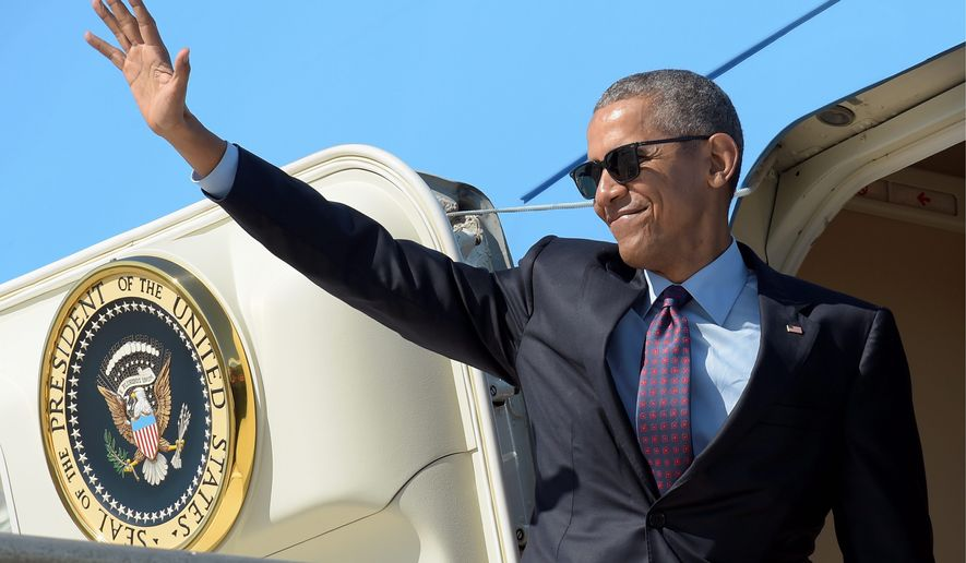 President Obama waves before boarding Air Force One after campaigning for Hillary Clinton in Los Angeles in the 2016 campaign. (Associated Press)