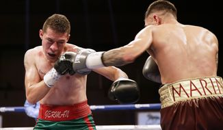 German Meraz, left, and Alexandru Marin trade punches during a bantamweight fight at the MGM National Harbor, Oxon Hill, Md., Saturday, May 20, 2017. (AP Photo/Mark Tenally)