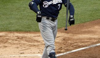 Milwaukee Brewers' Eric Thames (7) throws his bast after striking out against the Chicago Cubs during the fourth inning of a baseball game, Friday, May, 19, 2017, in Chicago. (AP Photo/David Banks)