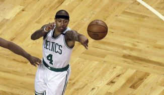 Boston Celtics guard Isaiah Thomas (4) passes the ball as Cleveland Cavaliers guard Kyrie Irving (2) defends during the first quarter of Game 2 of the NBA basketball Eastern Conference finals,, Friday, May 19, 2017, in Boston. Thomas did not return in the second half due to a strained right hip. (AP Photo/Elise Amendola)