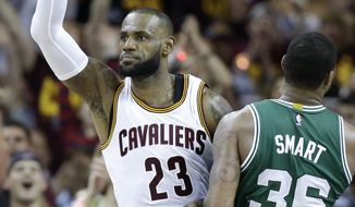 Cleveland Cavaliers' LeBron James (23) celebrates against Boston Celtics' Marcus Smart (36) during the first half of Game 3 of the NBA basketball Eastern Conference finals, Sunday, May 21, 2017, in Cleveland. (AP Photo/Tony Dejak)