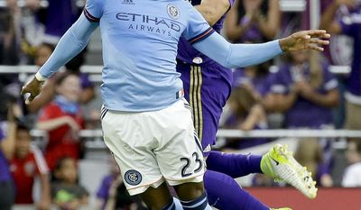 New York City FC's Rodney Wallace, left, and Orlando City's Scott Sutter, right, try to head the ball to a teammate for possession during the first half of an MLS soccer game, Sunday, May 21, 2017, in Orlando, Fla. (AP Photo/John Raoux)