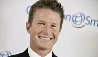 In this Sept. 19, 2014 file photo, Billy Bush arrives at the Operation Smile's 2014 Smile Gala in Beverly Hills, Calif. (Photo by Richard Shotwell/Invision/AP, File)
