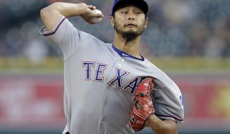 Texas Rangers starting pitcher Yu Darvish throws during the first inning of a baseball game against the Detroit Tigers, Sunday, May 21, 2017, in Detroit. (AP Photo/Carlos Osorio)