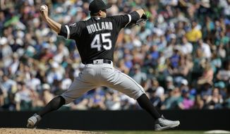 Chicago White Sox starting pitcher Derek Holland throws against the Seattle Mariners in the eighth inning of a baseball game, Sunday, May 21, 2017, in Seattle. (AP Photo/Ted S. Warren)