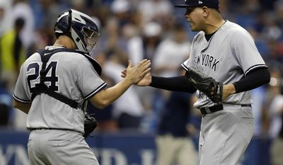 New York Yankees relief pitcher Dellin Betances, right, celebrates with catcher Gary Sanchez after closing out the Tampa Bay Rays in the ninth inning of a baseball game Sunday, May 21, 2017, in St. Petersburg, Fla. (AP Photo/Chris O'Meara)