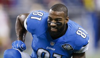 In this Sunday, Dec. 27, 2015, file photo, Detroit Lions wide receiver Calvin Johnson (81) warms ups before an NFL football game against the San Francisco 49ers at Ford Field in Detroit. (AP Photo/Rick Osentoski)