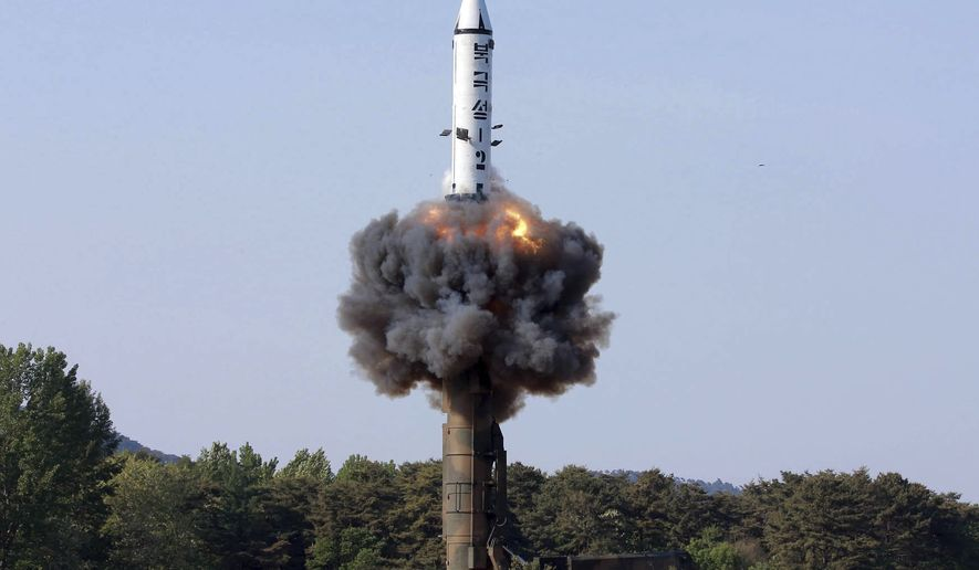 """CORRECTS TO UNDATED PHOTO - In this undated photo distributed by the North Korean government Monday, May 22, 2017, a solid-fuel """"Pukguksong-2"""" missile lifts off during its launch test at an undisclosed location in North Korea. North Korea fired a solid-fuel ballistic missile Sunday that can be harder for outsiders to detect before launch and later said the test was hailed as perfect by leader Kim Jong Un. The official Korean Central News Agency confirmed Monday the missile was a Pukguksong-2, a medium-to-long range ballistic missile also launched in February. The missile flew about 500 kilometers (310 miles) and reached a height of 560 kilometers (350 miles) Sunday before plunging into the Pacific Ocean. Independent journalists were not given access to cover the event depicted in this photo. (Korean Central News Agency/Korea News Service via AP)"""