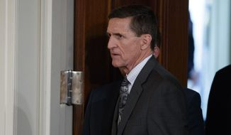 Mike Flynn arrives for a news conference in the East Room of the White House in Washington in this Feb. 13, 2017, file photo. The former national security adviser will invoke his Fifth Amendment protection against self-incrimination on Monday, May 22, 2017, as he notifies the Senate Intelligence committee that he will not comply with a subpoena seeking documents. (AP Photo/Evan Vucci, File)