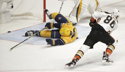 Anaheim Ducks right wing Ondrej Kase (86), of the Czech Republic, shoots the puck past Nashville Predators defenseman Matt Irwin (52) for a goal during the second period in Game 6 of the Western Conference final in the NHL hockey Stanley Cup playoffs Monday, May 22, 2017, in Nashville, Tenn. (AP Photo/Mark Zaleski)
