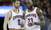 Cleveland Cavaliers' LeBron James (23) talks with Kevin Love (0) against the Boston Celtics during the second half of Game 3 of the NBA basketball Eastern Conference finals, Sunday, May 21, 2017, in Cleveland. The Celtics won 111-108. (AP Photo/Tony Dejak)