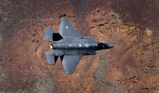 FILE - In this Feb. 28, 2017, file photo, a Lockheed Martin F-35A Lighting II from the 323 Squadron, Royal Netherlands Air Force flies through the nicknamed Star Wars Canyon on the Jedi transition in Death Valley National Park, Calif. Shares of three major U.S. defense contractors are hitting all-time highs, Monday, May 22, 2017, in the first day of trading after President Donald Trump bestowed Saudi Arabia with a $110 billion arms deal. The deal, which could expand up to $350 billion over 10 years, sent shares of Lockheed Martin Corp., Northrop Grumman Corp. and Raytheon Co. to unprecedented heights. (AP Photo/Ben Margot, File)