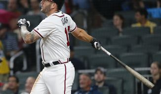 Atlanta Braves first baseman Matt Adams (18) follows through on a two-run home run in the fifth inning of a baseball game against the Pittsburgh Pirates, Monday, May 22, 2017, in Atlanta. (AP Photo/John Bazemore)