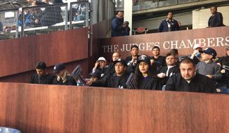 Fans sit in the rooting section for New York Yankees rookie Aaron Judge at Yankee Stadium in New York, Monday, May 22, 2017. Looking like a jury box and known as The Judge's Chambers, the section is just behind where Judge plays right field. (AP Photo/Ben Walker)