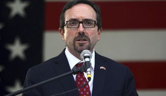 """FILE - In this July 2, 2105 poo-file photo, U.S. Ambassador to Turkey John Bass speaks in Ankara, Turkey. Turkey summoned Bass Monday, May 22, 2017, to protest what it called """"aggressive and unprofessional actions"""" by American security personnel against Turkish bodyguards during a violent incident last week in Washington. The U.S. ambassador told Turkey's government its guards violated U.S. laws, a senior U.S. official said.  (Pool Photo/Adem Altan via AP, File)"""