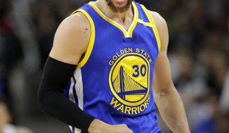 Golden State Warriors guard Stephen Curry (30) celebrates a basket against the San Antonio Spurs during the second half in Game 4 of the NBA basketball Western Conference finals, Monday, May 22, 2017, in San Antonio. (AP Photo/Eric Gay)