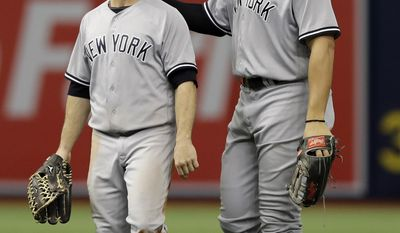New York Yankees left fielder Brett Gardner, left, celebrates with right fielder Aaron Judge after they defeated the Tampa Bay Rays in a baseball game Sunday, May 21, 2017, in St. Petersburg, Fla. (AP Photo/Chris O'Meara)