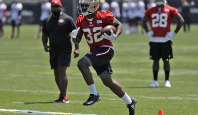 San Francisco 49ers running back Joe Williams (32) runs during the team's organized team activity at its NFL football training facility Tuesday, May 23, 2017, in Santa Clara, Calif. (AP Photo/Marcio Jose Sanchez)