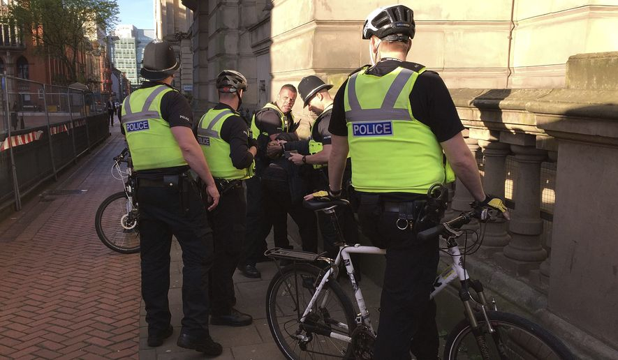 Police detained a man Tuesday near a vigil for victims of the Manchester Arena bombings, but fans at the Ariana Grande concert said there was virtually no physical inspection of bags and knapsacks at the gates. (Associated Press)
