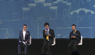Go player Ke Jie, center, speaks at a press conference after playing a match against Google's artificial intelligence program, AlphaGo, during the Future of Go Summit in Wuzhen in eastern China's Zhejiang Province, Tuesday, May 23, 2017. Ke Jie, the world's top-ranked Go player, started a three-round showdown on Tuesday against AlphaGo, which beat a South Korean Go master in a five-round showdown last year. (AP Photo/Peng Peng)
