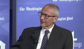 """John Podesta, former chairman of Hillary Clinton's failed 2016 presidential campaign, gave tepid praise for President Trump Tuesday morning, saying the president is """"doing OK"""" so far on his first foreign trip since taking office. (The Washington Post)"""