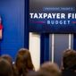 Counselor to the President Kellyanne Conway listens as Budget Director Mick Mulvaney speak to the media about President Donald Trump's proposed fiscal 2018 federal budget in the Press Briefing Room at the White House in Washington, Tuesday, May 23, 2017. (AP Photo/Andrew Harnik)