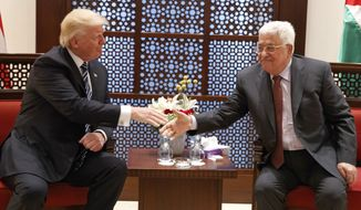 U.S. President Donald Trump, left,  meets with Palestinian President Mahmoud Abbas, Tuesday, May 23, 2017, in the West Bank City of Bethlehem. (AP Photo/Evan Vucci)