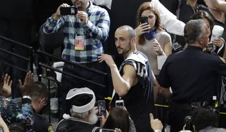 San Antonio Spurs guard Manu Ginobili (20) signals to fans as he walks off the court after Game 4 of the NBA basketball Western Conference finals against the Golden State Warriors, Monday, May 22, 2017, in San Antonio. Golden State won 129-115. (AP Photo/Eric Gay)
