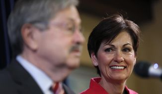Iowa Lt. Gov. Kim Reynolds listens at right as Iowa Gov. Terry Branstad speaks during a news conference, Tuesday, May 23, 2017, at the Statehouse in Des Moines, Iowa. Branstad was confirmed on Monday, May 22, 2017, as the next U.S. ambassador to China. Reynolds will be sworn in as Iowa Governor during a ceremony on Wednesday after Branstad resigns. (AP Photo/Charlie Neibergall)