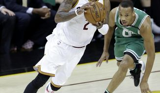 Cleveland Cavaliers' Kyrie Irving (2) drives against Boston Celtics' Avery Bradley (0) during the first half of Game 4 of the NBA basketball Eastern Conference finals, Tuesday, May 23, 2017, in Cleveland. (AP Photo/Tony Dejak)