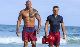 "This image released by Paramount Pictures shows Dwayne Johnson as Mitch Buchannon, left, and Zac Efron as Matt Brody in ""Baywatch."" (Frank Masi/Paramount Pictures via AP)"