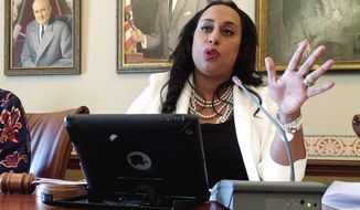 Illinois state Sen. Toi Hutchinson, D-Olympia Fields, discusses changes in the tax-increase package on Tuesday, May 23, 2017, in Springfield, Ill. Democrats in the Senate are preparing a budget plan that can be approved without Republican help as time winds down to the scheduled May 31 adjournment. (AP Photo/John O'Connor)