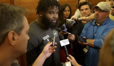 New York Jets' Sheldon Richardson talks to reporters during the team's organized team activities at its NFL football training facility, Tuesday, May 23, 2017, in Florham Park, N.J. (AP Photo/Julio Cortez)