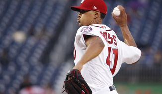 Washington Nationals starting pitcher Joe Ross (41) throws a pitch during the first inning of a baseball game against the Seattle Mariners in Washington, Tuesday, May 23, 2017. (AP Photo/Manuel Balce Ceneta)