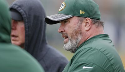 Green Bay Packers head coach Mike McCarthy talks with coaches during NFL football practice Tuesday May 23, 2017, in Green Bay, Wis. (AP Photo/Matt Ludtke)
