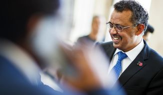 Dr Tedros Adhanom Ghebreyesus, from Ethiopia, candidate to the position of Director General of the World Health Organization (WHO), leaves after delivering a 15-minute speech during the 70th World Health Assembly at the European headquarters of the United Nations in Geneva, Switzerland, Tuesday, May 23, 2017. (Valentin Flauraud/Keystone via AP)
