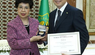 FILE - In this Wednesday, June 11, 2014 file photo, WHO's Margaret Chan meets with Turkmenistan's President Gurbanguli Berdymukhamedov in Ashgabat, Turkmenistan. After leading the World Health Organization for the last decade, Dr. Margaret Chan knows all too well how politics infuses actions at nearly every level of the U.N. agency. As WHO member countries prepare to elect her successor on Tuesday, May 23, 2017, the Associated Press reveals eyebrow-raising details from internal documents that show how she appeased dictators in Turkmenistan and North Korea - and told then-Prime Minister Vladimir Putin she'd see to how WHO might hire more Russians. (AP Photo, file)
