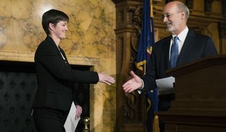 Gov. Tom Wolf shakes hands with Teresa Miller during a news conference at the Pennsylvania Capitol in Harrisburg, Pa., Tuesday, May 23, 2017. Wolf says he'll nominate his insurance commissioner, Miller, to lead a new agency overseeing public health and human services programs. (AP Photo/Matt Rourke)