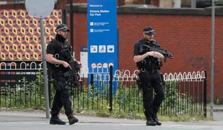 Britons will find armed troops at vital locations Wednesday after the official threat level was raised to its highest point following a suicide bombing on Monday that killed 22. (Associated Press)