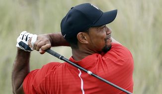 In this Dec. 4, 2016, file photo, Tiger Woods watches his tee shot on the third hole during the final round at the Hero World Challenge golf tournament in Nassau, Bahamas. (AP Photo/Lynne Sladky, File)