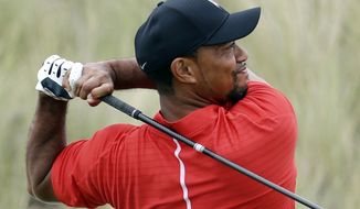 """FILE - In this Dec. 4, 2016, file photo, Tiger Woods watches his tee shot on the third hole during the final round at the Hero World Challenge golf tournament in Nassau, Bahamas. Woods said he had fusion surgery on his back because he could no longer tolerate the pain, and that he wants to get back on the PGA Tour.  """"I haven't felt this good in years,"""" he said Wednesday, May 24, 2017, in an update on his website.  Woods had the fusion surgery on April, his fourth surgery on his back dating to the spring of 2014 , and said it provided """"instant nerve relief."""" (AP Photo/Lynne Sladky, File)"""