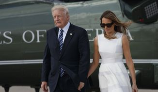 In this Tuesday, May 23, 2017, file photo, President Donald Trump and and his wife Melania hold hands as they walk from Marine One to board Air Force One, enroute to Rome, in Jerusalem. On Monday on his arrival at Ben-Gurion International Airport, President Trump turned and reached out to grab Mrs. Trump's hand and she appeared to brush away his hand, raising speculation in local media of a possible first family fracas. It happened again in Rome on Tuesday. (AP Photo/Evan Vucci, File)
