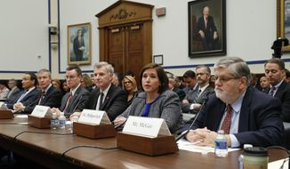 FILE - In this Tuesday, May 2, 2017, file photo, American Airlines Senior Vice President of Customer Experience Kerry Philipovitch, second from right, testifies on Capitol Hill in Washington, before a House Transportation Committee oversight hearing. From left are: United Airlines CEO Oscar Munoz; United Airlines President Scott Kirby; Joseph Sprague, senior vice president of external relations, Alaska Airlines; Bob Jordan, executive vice president and chief commercial officer, Southwest Airlines, and Consumers Union aviation consultant William J. McGee. Be careful what you video on your next flight, as it could be against airline rules. Major U.S. airlines say they limit what you can photograph or capture on video. However, lawyers say the policies might not stand up in court. (AP Photo/Pablo Martinez Monsivais, File)