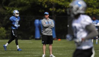 Detroit Lions general manager Bob Quinn watches during an NFL football practice in Allen Park, Mich., Wednesday, May 24, 2017. (AP Photo/Paul Sancya)