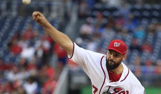 Washington Nationals starting pitcher Tanner Roark (57) throws a pitch during the first inning of a baseball game against the Seattle Mariners in Washington, Wednesday, May 24, 2017. (AP Photo/Manuel Balce Ceneta)