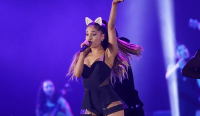 FILE - In this Aug. 26, 2015 file photo, Ariana Grande performs during the honeymoon tour concert in Jakarta, Indonesia. Grande's management team says the singer's concerts will be canceled through June 5, 2017, after a bombing following her concert in Manchester, England left 22 people dead. (AP Photo/Achmad Ibrahim, File)