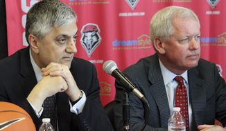 FILE - In this May 3, 2017 file photo, University of New Mexico acting president Chaouki Abdallah, left, and athletics director Paul Krebs listen to reporters' questions during a news conference in Albuquerque, N.M. Krebs, the head of the University of New Mexico's athletics department, is drawing criticism as more details emerge about the use of public money for a 2015 golf trip to Scotland. (AP Photo/Susan Montoya Bryan, file)