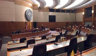 In this Tuesday, May 23, 2017 photo, the New Mexico state Senate chamber awaits the arrival of lawmakers for a special legislative session in Santa Fe, N.M. The session begins at noon Wednesday, May 24, 2017, with a focus on restoring vetoed funding to all state colleges and universities. Republican Gov. Susana Martinez and the Democratic-led Legislature have been feuding for months over how to fill a budget gap for the fiscal year starting July 1. (AP Photo/Morgan Lee)