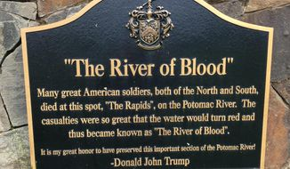 A plaque, displayed on a monument between the 15th and 16th holes at Trump National Golf Club in Sterling, Va., commemorates a Civil War battle that, according to some historians, never happened. The Senior PGA Championship is being played at Trump National this week, the first time a major golf tournament has been played at a course owned by a sitting president. The course has been targeted by vandals since Trump took office, and protests are expected this weekend. AP Photo/Ben Nuckols