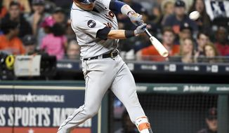 Detroit Tigers' Jose Iglesias hits a two-run home run off Houston Astros relief pitcher Jordan Jankowski with Tyler Collins during the ninth inning of a baseball game, Wednesday, May 24, 2017, in Houston. (AP Photo/Eric Christian Smith)
